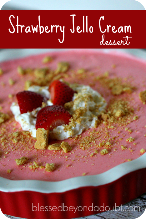 Super easy strawberry jello cream dessert. Make this and you will score. It's so fluffy and light!