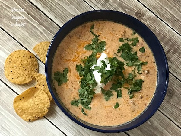 Try this delicious easy slow cooker taco soup with a twist. Check out the secret ingredient. You will want to add this to your list of easy cheap crockpot meals.